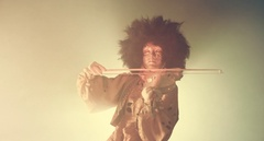Venetian masquerade violinist playing the violin in smoke and darkness. Stock Footage