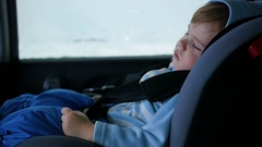 The baby is sleeping in the car in the way Stock Footage