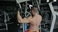 A man pumping his body in the gym Stock Footage