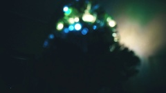 Blurred lights of Christmas tree: bokeh effect Stock Footage