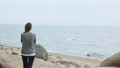 Girl with long dark hair in clothing the jacket Stock Footage