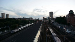 Railroad tracks at dusk. Trains passing by, Stockholm city railway Stock Footage