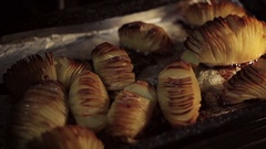 Baking sliced potatoes with garlic in the oven Stock Footage