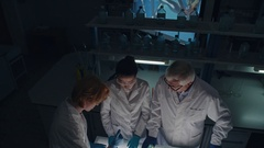 Biologists Mixing Chemicals in Lab Stock Footage
