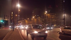 WARSAW, POLAND - DECEMBER, 22, 2016. City road traffic in the evening. 4K pan Stock Footage