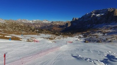 Aerial View of Dolomites (Alps) Mountains in Winter, Skiers on Ski Slope Stock Footage