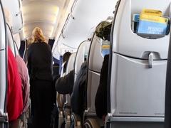 AIrlines passenger cabin flight attendant serving drinks DCI 4K Stock Footage