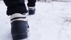 Man walking through deep snow Stock Footage