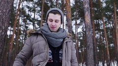 A man talking on the phone in the winter forest Stock Footage