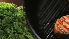 Preparing salmon fillets on the grill pan Stock Footage