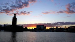 Stockholm City Hall silhouette at sunset Stock Footage