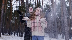 Cheerful couple enjoying their winter activity playing with snow Stock Footage