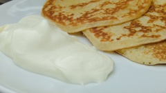 Close up plate with pancakes and sour cream Stock Footage