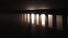 Cars behind a guardrail. Traffic, foggy night Stock Footage
