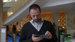 Tourist reads an information booklet stand near the hotel Stock Footage
