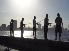 Local fishermen are fishing on the pier in Havana at sunset Stock Footage
