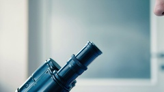 Lab technician looks through a microscope. Stock Footage