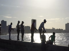 Fishermen are fishing on the pier of Havana at sunset Stock Footage