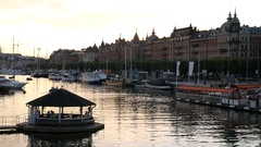 City canal in Stockholm at dusk. Jetty, boat marina and buildings Stock Footage