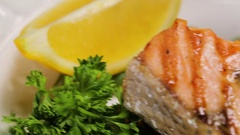Preparing salmon fillets on the plate Stock Footage
