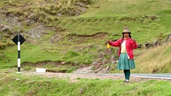 Shepherdess spinning wool in Andes of Peru, South America Stock Footage