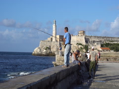 Man is fishing on the waterfront of Havana at sunset Stock Footage