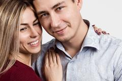 Man and woman. Portrait of a beautiful heterosexual couple. Face closeup Stock Photos