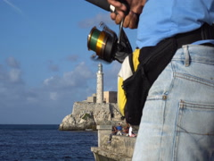 Close-up view of a man spinning reel the bait on pier Stock Footage