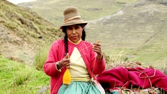 Shepherdess spinning wool in Andes of Peru, South America Stock Footage
