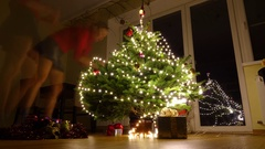 Young woman decorating Christmas tree at home. 4K timelapse Stock Footage