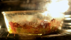 Gratin in baking dish cooking in oven Stock Footage