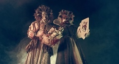 Actors Venetian masquerade costumes on stilts with playing cards. Stock Footage