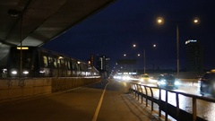Subway train and cars passing by at night Stock Footage