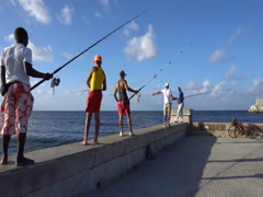 View of the fishermen along seafront in Havana at sunset Stock Footage