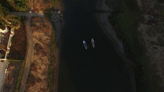 Drone view of paddle boarders on channel Stock Footage