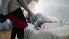 Mother embracing her baby one year old toddler in baby room during afternoon nap Stock Footage