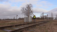 Railway electrician with cable walking on railway Stock Footage