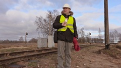Railway electrician drink coffee and walking Stock Footage