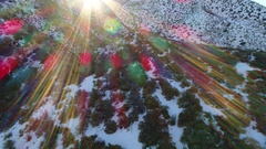 Gorgeous aerial video with sunflare of snowy mountains Stock Footage