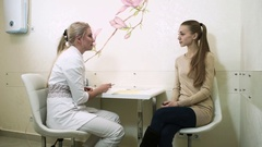 Cosmetology. The blonde girl during the consultation at the cosmetic surgeon. HD Stock Footage