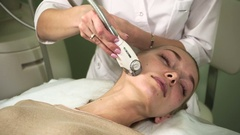 The cosmetician performing the procedure of LPG massage on the female face. HD Stock Footage