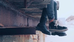Elegant outfit. Close Up women ankle boots and men winter boots. lifestyle Stock Footage