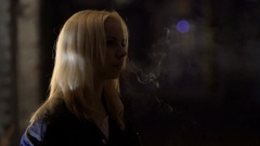 Young depressed woman smoking nervously near night club, loneliness, break-up Stock Footage