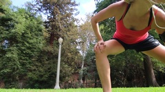 A woman runner warming-up and stretching before her run. Stock Footage