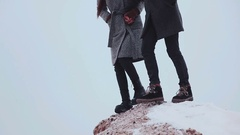 Legs of two people, run outside in winter nature Stock Footage