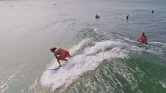 Surf Girl Berawa Bali Indonesia Slowmotion Aerial Stock Footage
