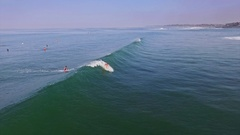 Bali Girl Surfing Waves Slowmotion Aerial Stock Footage