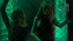 Pretty female go-go dancers moving to music in trance at nightclub, illumination Stock Footage