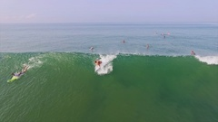Girl Surfing Ocean Bali Indonesia Slowmotion Aerial Stock Footage