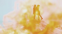 Couple standing against a background of fire, on the hill of sand. Winter sea Stock Footage